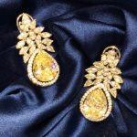 floral and leaf motif earrings